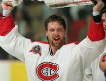 In this June 9, 1993, file photo, Montreal Canadiens goalie Patrick Roy hoists the Stanley Cup Trophy after the Canadiens defeated the Los Angeles Kings in Montreal to win the Stanley Cup. (AP Photo/The Canadian Press, Ryan Remiorz, File)