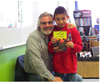 Grade 4 student Chase Gordon with David Bouchard, last year, during Bouchard's visit to Mother Earth's Children's Charter School - Photo submitted.