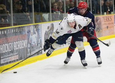 The Spruce Grove Saints' Austin Hunter (14) battles the Brooks Bandits' Austin Wright (14) during first period AJHL action at Grant Fuhr Arena, in Spruce Grove Alta. on Friday April 15, 2016. Photo by David Bloom