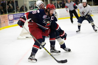 The Spruce Grove Saints' Macklin Pichonsky (2) battles the Brooks Bandits' Derek Lodermeier (18) during second period AJHL action at Grant Fuhr Arena, in Spruce Grove Alta. on Friday April 15, 2016. Photo by David Bloom