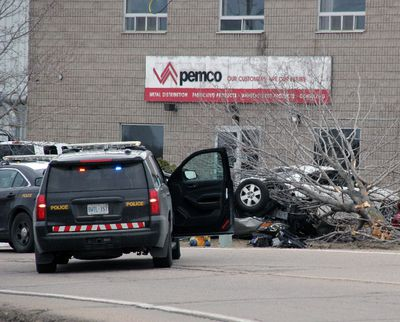 Pembroke OPP surround a van that had been involved in an accident at 10 a.m. on Paul Martin Dr., in front of Pemco Steel.  York Regional Police said the vehicle was involved in an Amber Alert on April 18, 2016. (Stephen Uhler/Postmedia Network)