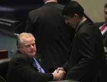 Toronto Mayor Rob Ford gets congratulated by chief of staff Nick Kouvalis after council voted to kill the car tax December 16, 2010. (Stan Behal/Toronto Sun files)