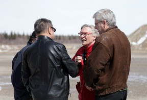 Indigenous Affairs Minister Carolyn Bennett is greeted at the Attawapiskat airport by Chief Bruce Shisheesh on Monday, April 18, 2016, as NDP MP Charlie Angus (right) looks on. The remote First Nations community in northern Ontario has been hit hard by youth attempts at suicide. THE CANADIAN PRESS/Colin Perkel