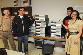 Tejutla Chalatenango, El Salvador Mayor Rafael Tejada stands in front of refurbished computers that will be shipped to remote towns and villages in the central American country. Tejada was on hand to thank Lambton College's Information Technology Professional program for donating over 200 refurbished PCs to rural municipalities in El Salvador on Apr. 13. From left to right: ITP coordinator Chuck Fisher, Mayor Tejada, Mario and Dolores Quintanilla.  CARL HNATYSHYN/SARNIA THIS WEEK