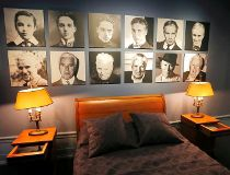 Portraits of Charlie Chaplin are pictured above his bed during a media visit of 'Chaplin's World' in Corsier