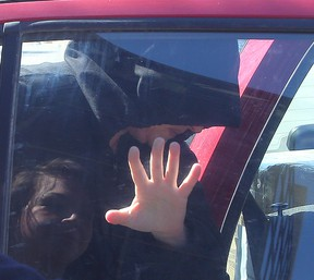 Andrea Giesbrecht tries to hide her face as she leaves the Law Courts in this file photo.