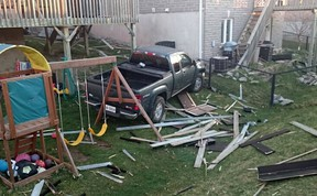 The pick up truck before being removed from the Weston Crescent  backyard Wednesday morning after it left Taylor Kidd Boulevard in Kingston, Ont. at approximately 9:15 p.m. on Tuesday April 19, 2016. Supplied photo