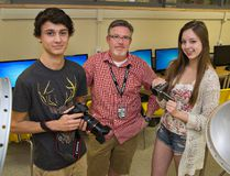 Dave McCreary, video production and graphic design teacher at Brantford Collegiate Institue, stands with students Samuel Forsyth and Vanessa Hill, who have submitted entries to Cross Cuts 2016 Film Fest, the third annual short film festival. (Brian Thompson/The Expositor)