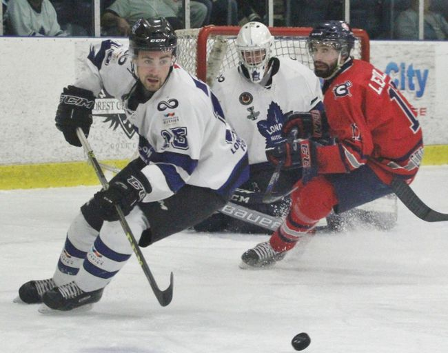 Matt Doty of the London Nationals carries the puck out of his zone with Stratford Culliton Dylan Lebold in pursuit during the first period of Game 4 of the Sutherland Cup semifinal Wednesday at Western Fair. (Cory Smith, Postmedia Network)