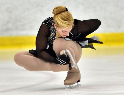 Katie Pagnello, from the Athens Figure Skating Club, performs a sit spin variation. Pagnello will be competing at the Adult Figure Skating Championships this weekend. (Photo taken by Danielle Earl)