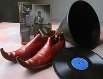 A private collector has donated material from London's dance band era to the Jack Richardson London Music Awards steering committee for historical displays. Seen here are 78s by the late singer Gayle Gordon, a 1953 CFPL-TV image of Gordon, Gordon's Shrine band shoes and a megaphone associated with dance band leader Alf Tibbs, for whose band Gordon was a star. (MORRIS LAMONT, The London Free Press)