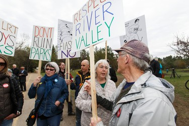 Save Our Footbridge members organize during a ground breaking ceremony for the Valley Line LRT near the Muttart Conservatory in Edmonton, Alta., on Friday April 22, 2016. Demonstrators held placards behind the politicians while the groundbreaking was held. Photo by Ian Kucerak
