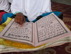 <p>An Afghan Muslim girl reads the Qur'an, Islam's holy book, at a mosque in Kandahar south of Kabul, Afghanistan, Wednesday, March 2, 2016.</p><p> (AP Photo/Allauddin Khan)