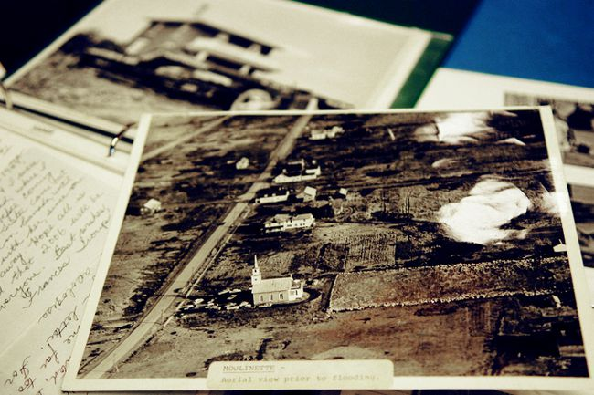 <p>Archived photos lay on the table in the Forbes building at Lost Villages Museum in Long Sault in this 2011 file photo. The front photo is the remainder of the homes and barns in the village of Moulinette before they were destroyed to create the St. Lawrence Seaway. </p><p> ERIKA GLASBERG/CORNWALL STANDARD-FREEHOLDER/Postmedia Network