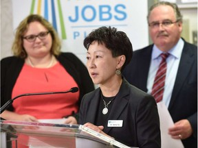 Alberta Health Services Dr. Verna Yu is flanked by Health Minister Sarah Hoffman and Infrastructure Minister Brian Mason to announce a $759.5-million maintenance and renewal of Alberta's health-care facilities at a University Hospital news conference in Edmonton, April 22, 2016. (Ed Kaiser photo)