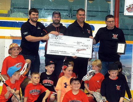 Wallaceburg Thrashers president Steve Lilley, from left, Wallaceburg Minor Lacrosse president Rory Smith, Wallaceburg Red Devils president Gord Lilley, and Wallaceburg Minor Lacrosse past chairman and fundraising chairman Chris Dawson celebrate receiving an Ontario Trillium Fund grant for $266,800 on Sunday at Wallaceburg Memorial Arena. (DAVID GOUGH/Postmedia Network)