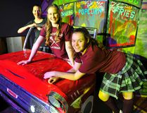 Rachel Sys (left), Erin Staley, and Jennifer Donck, all 14, play cheerleaders in Langton's annual community variety show, which runs this weekend. This year's production has a 1950s theme. (DANIEL R. PEARCE Simcoe Reformer)