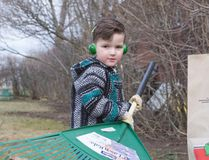 Noah Asher Currie, 4, puts what he has learned at school to practise, by making sure yard waste from spring cleanup goes into paper bags for curbside pick up and composting. Earth Day was Friday. Ali Pearson/Sault This Week