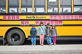 Red Lights Flashing — No Passing!  After a couple of cars passed school buses with their red lights flashing in town and the MD, Sharon Robert, manager of First Student, knew it was time to re-educate the people of Pincher Creek about bus safety.  | Caitlin Clow photo/Pincher Creek Echo