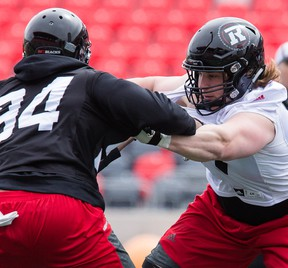 Offensive lineman Jesse Peterson (right) during the final day of the RedBlacks mini-camp at TD Place in Ottawa on Tuesday, April 26, 2016. (Errol McGihon)