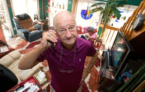 Gerald Fleming grew skeptical on a recent phone call from a scam artist masquerading as a Canada Revenue Agency official who demanded Fleming send him money or face penalties.  (CRAIG GLOVER, The London Free Press)