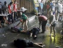 In this April 13, 2016 image taken from video released by the Hua Hin Municipality, an elderly British couple and their son are on the ground after they were savagely attacked during a family vacation in Hua, Hin, Thailand. (Hua Hin Municipality via AP)