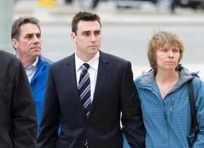 Jared Dejong, middle, arrives at the court house with supporters for his sentencing after pleading guilty in March in the drunk driving death of Western University student Andrea Christidis, in London, Ont. on Thursday April 28, 2016. (CRAIG GLOVER, The London Free Press)