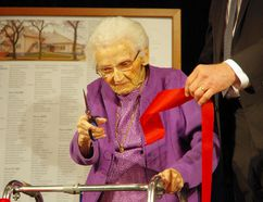 Marg Durham (centre) saw Manitou's Opera House go up in 1930. One of the community's long-time members to benefit from the buildings new accessibility upgrades, Durham cut the ribbon on the over $1 million project April 23. (Alexis Stockford/The Morden Times)