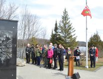Photo by KEVIN McSHEFFREY/THE STANDARD The Last Post was played as the Ontario flag was lowered to halfmast at this year's National Day of Mourning ceremony at the Miners Memorial Park in Elliot Lake on Thursday, April 28. At the left, Mayor Dan Marchisella joined family members of the four former Elliot Lake mineworkers whose names were added to the memorial this year. The four died as a result of a workplace related accident or illness. For more on the ceremony, see next week's edition of The Standard.