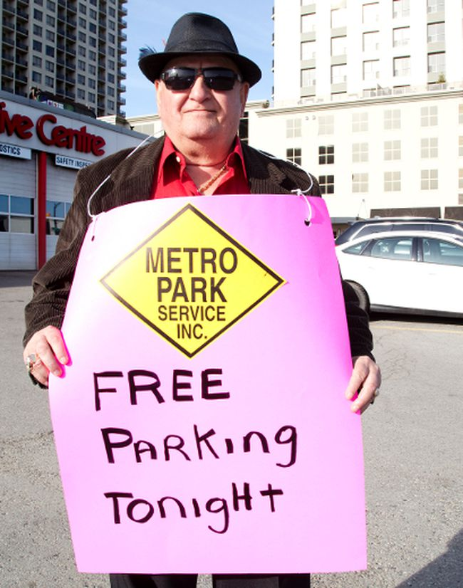 Dennis Dimitrikopoulos offered free parking to people attending the London Knights hockey game in London on Wednesday. (DEREK RUTTAN, The London Free Press)