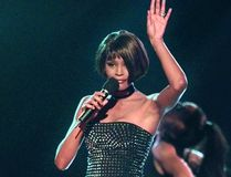 In this March 26, 1999 file photo, singer Whitney Houston performs at the 13th annual Soul Train Music Awards in Los Angeles. An official Whitney Houston documentary is in the works from Oscar-winning filmmaker Kevin Macdonald. (AP Photo/Mark J. Terrill, File)