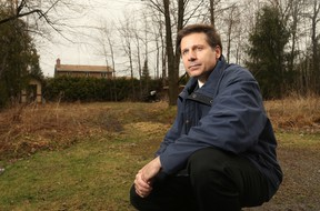 Bob Medwenitsch kneels in front of a parcel of land he owns in Osgoode. It has been the subject of a long-running dispute with bylaw and it is the last thing he and his wife, Laura (who suffered two strokes last year), need, he says.