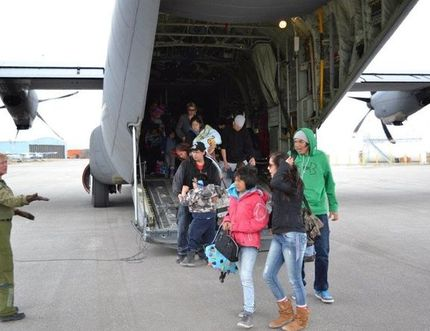 A file photo from 2014 shows evacuees from Kashechewan disembarking from a Hercules aircraft at the Kapuskasing airport due to the threat of the Albany River flooding. About 700 Kashechewan residents are being evacuated today and Saturday, as a precautionary measure as there is a growing threat of the First Nation community flooded again.