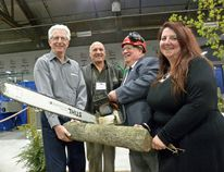 Ernst Kuglin/The Intelligencer Bay of Quinte Home Show vice-chair Own Kinmond, chair Rick Davies, Mayor Jim Harrison, with a whopping big chainsaw, and Quinte West Chamber of Commerce President Cindy Dow officially opened the show Friday afternoon at Memorial Gardens in Trenton. The show runs Saturday and Sunday.