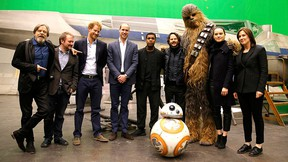 (L-R) Mark Hamill, director Rian Johnson, Prince Harry, Prince William, Duke of Cambridge, British actor John Boyega, Chewbacca and British actress Daisy Ridley pose during a tour of the Star Wars sets at Pinewood studios in Iver Heath, west of London, Britain on April 19, 2016. REUTERS/Adrian Dennis/Pool