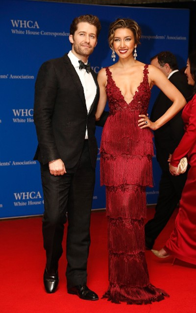 Actor Matthew Morrison and wife, Renee Puente, arrive on the red carpet for the annual White House Correspondents Association Dinner in Washington, U.S., April 30, 2016. REUTERS/Jonathan Ernst