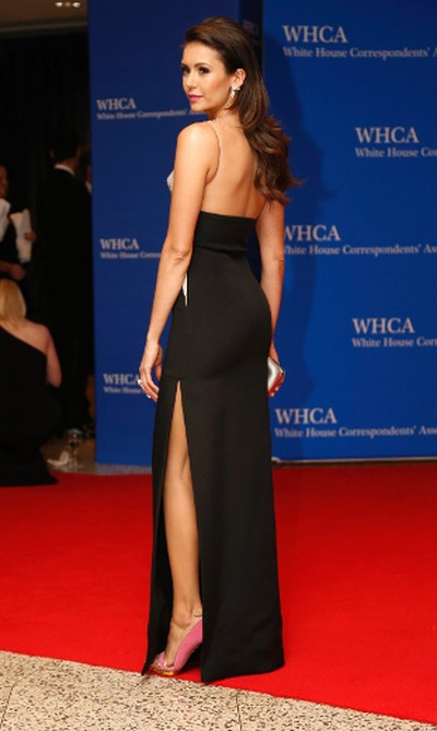 Actress Nina Dobrev arrives on the red carpet for the annual White House Correspondents Association Dinner in Washington, U.S., April 30, 2016. REUTERS/Jonathan Ernst