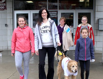 Participating in the annual Mandarin MS Walk has been an 18-year tradition for Kristie Grozelle, middle front, since her mom, Pam Hamilton, was diagnosed with MS. She was joined by her nieces Grace Hamilton, 11, left, and Sadie Hamilton, 9, right, her aunt Janey VanGeothem, back left, and Sherry Perritt, along with Grozelle's dog Tucker, all members of team Pam's Bothwellities, as they took part in the local MS Walk in Chatham, Ont. on Sunday May 1, 2016. Ellwood Shreve/Chatham Daily News/Postmedia Network