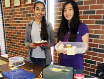 Sean Chase/Daily Observer Mackenzie students Jiya Dadhiala (left) and Anna Li were pulling bake sale duty during the Deep River school's annual Spring Fling fundraiser on Saturday. The event, hosted by the student council and the Interact Club, hoped to raise money to support a new Syrian refugee family anticipated to move to the area in the coming months.