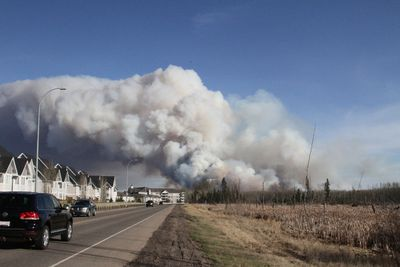 A forest fire burns as viewed from Real Martin Drive in Fort McMurray Alta. on Sunday May 1, 2016. Robert Murray/Fort McMurray Today/Postmedia Network