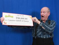 Lawrence Quibell of Ramore celebrates his $50,000 winnings.