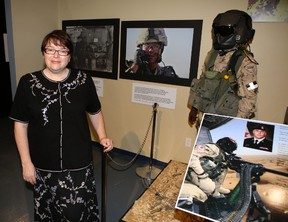Elliot Ferguson/The Whig-Standard A new exhibition at the Military Communication and Electronics Museum illustrates the shared experiences of soldiers in the First World War and Afghanistan, says museum manager Karen Young.