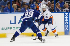 New York Islanders centre John Tavares skates with the puck as Tampa Bay Lightning defenceman Nikita Nesterov defends during the second period of Game 2 of the second round in the NHL playoffs at Amalie Arena in Tampa on April 30, 2016. (Kim Klement/USA TODAY Sports)