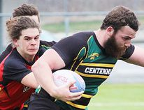 Centennial ballcarrier Curtis Courneyea plows forward against Bayside opposition during a recent senior boys rugby match at MAS Park. The annual Chargers Classic tournament is Thursday at MAS Park. (Submitted photo)