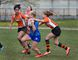 Samantha Terpstra (left) and Taylor Cicoria of North Park Collegiate move in to tackle BCI ball carrier Alex Klunder on Monday during a high school girls rugby match at Tollgate Tech. (BRIAN THOMPSON/The Expositor)