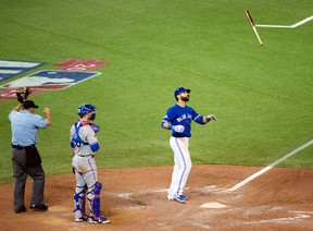 In this Oct. 14, 2015, file photo, Toronto Blue Jays' Jose Bautista flips his bat in the air while celebrating his three-run home run during the seventh inning in Game 5 of baseball's American League Division Series against the Texas Rangers in Toronto. (Darren Calabrese/The Canadian Press via AP, File)