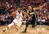 Raptors guard Kyle Lowry (left) dribbles past Pacers guard George Hill (right) during the fourth quarter of Game 7 of their first round NBA playoff series in Toronto on Sunday, May 1, 2016. (Dan Hamilton/USA TODAY Sports)