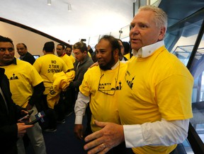 Former councillor Doug Ford arrives to support taxi drivers at the Toronto city council meeting dealing with new rules for Uber and the taxi industry on Tuesday, May 3, 2016. (Michael Peake/Toronto Sun)