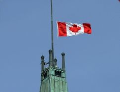 The Canadian flag on top of the Peace Tower on Parliament Hill will fly at half-mast in Ottawa on May 12. (File photo)