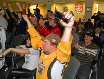 Ernst Kuglin/The Intelligencer Fans jumped out their chairs in Quinte West council chambers Tuesday as the Trenton Golden Hawks defeated the Soo Thunderbirds 4-2 in their opening game of the Dudley-Hewitt Cup in Kirkland Lake. Game 2 will be broadcast at the Memorial Gardens in Trenton beginning at 2 p.m. Everyone is welcome. Admission is free.